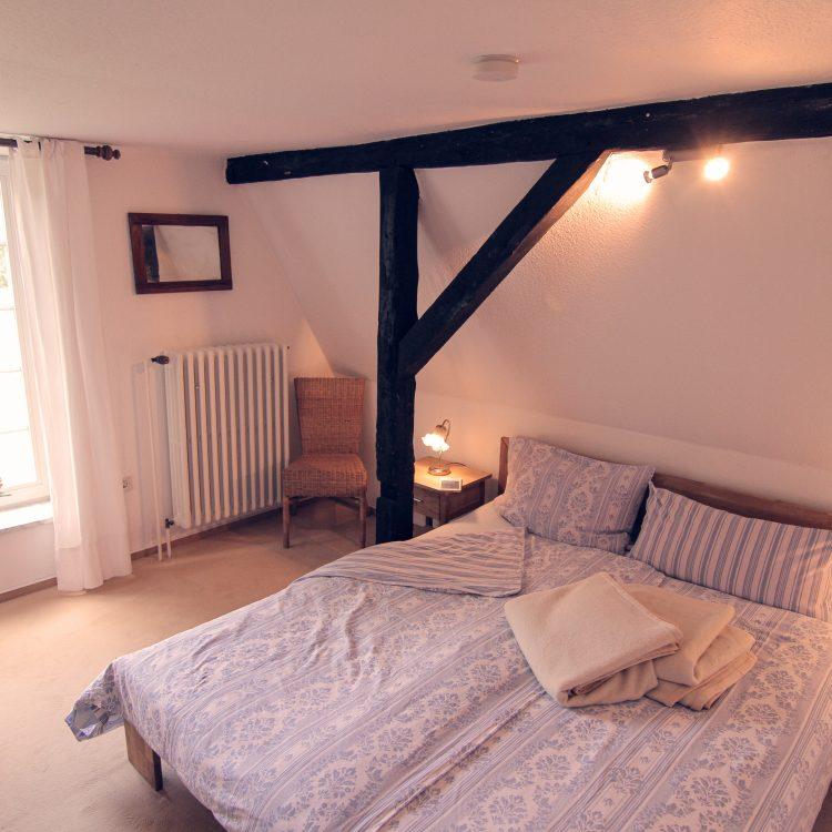 Schlafzimmer in der Ferienwohnung Sperlingslust